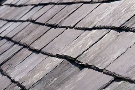 damaged roof: Close up with selective focus of an old slate roof Stock Photo