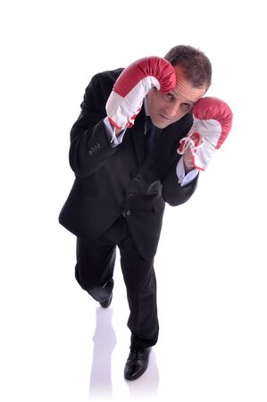 Image isolated on white of a business in a defensive boxing pose Stock Photo