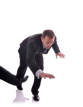 insurance themes: Image of a business man being tripped up