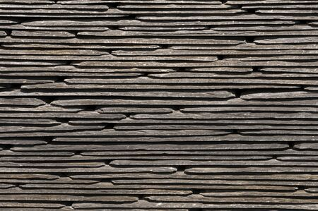 Close up of rooffing slates stacked to create a pattern or texture