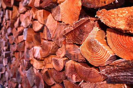 Close up with selective focus of a pile of chopped firewood or logs Stock Photo
