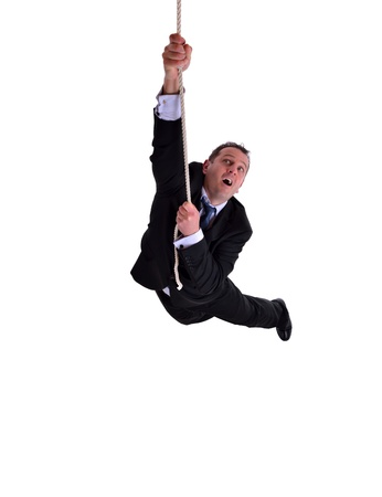 dangle: image of a businessman hanging on a rope. Isolated on white