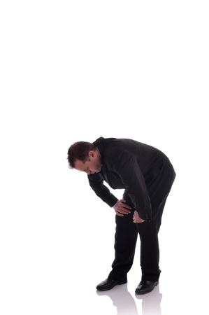 Image of a businessman in a crouched position out of breath  Image is isolated on white