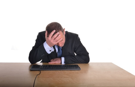 over burdened: Image of a businessman in a stressed pose at a desk Stock Photo