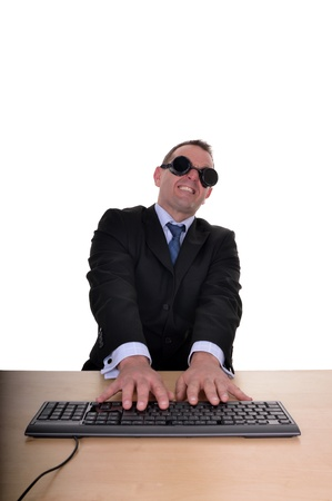 Image of a businessman at a desk with dark goggles but leaning back from something too bright