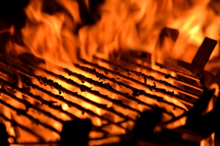 Close up image of a BBQ grill with flames