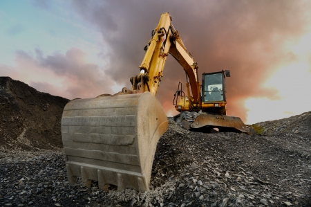 heavy equipment: Image of a wheeled excavator on a quarry tip