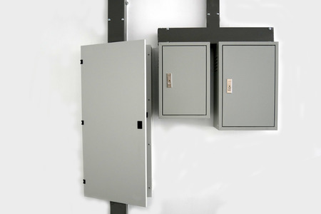 Electrical switchboard on the wall Keep the cord neat Protect from electric shock white wall Imagens