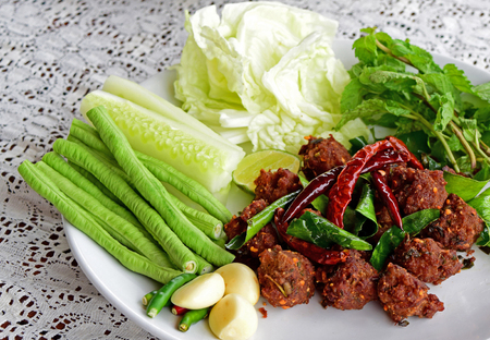 cooked pepper ball: Fired pork with spices in thai style