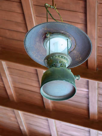 wooden  ceiling: thai antique lamp hanging on the wooden ceiling