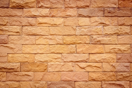 A brick wall in different natural orange tones