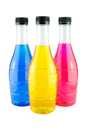 Bright colorful water in bottles on white background photo