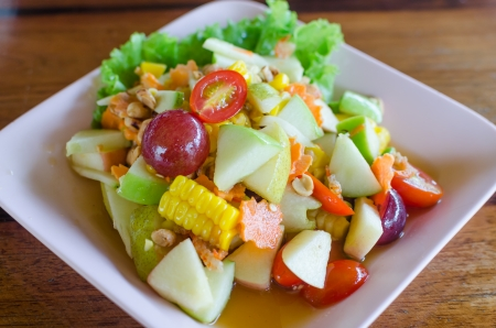 Thailand style fruit salads, mixed fresh fruit with  sauce tastes sour, salty, sweet  photo