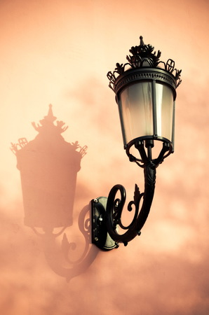 Vintage lantern and shadow on a wall. photo