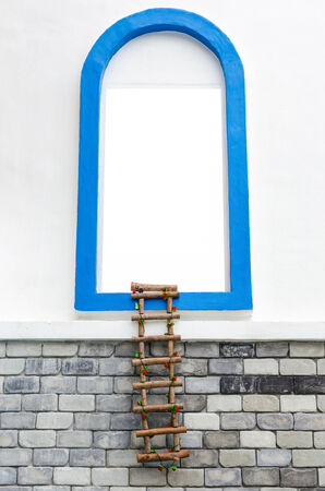 clandestine: window with white copyspace and rope ladder on wall.