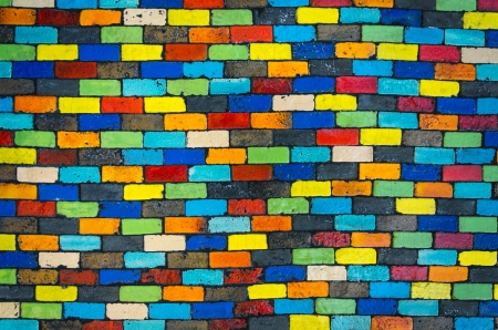Colorful brick wall - beautiful variety colors red green yellow blue cement pattern  photo