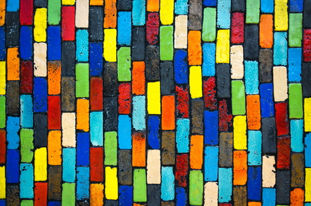Colorful brick wall - beautiful variety colors red green yellow blue cement pattern background photo