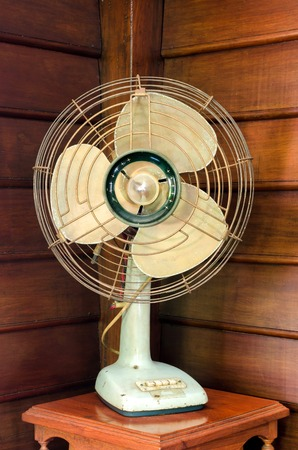 old electric fan on wood table