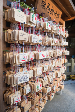 ema: KYOTO, JAPAN - March 06: Ema are small wooden plaques which Shinto worshippers write their prayers then leave hanging up at the shrine, at Kinkaku-ji on March 06, 2015 in Kyoto, Japan