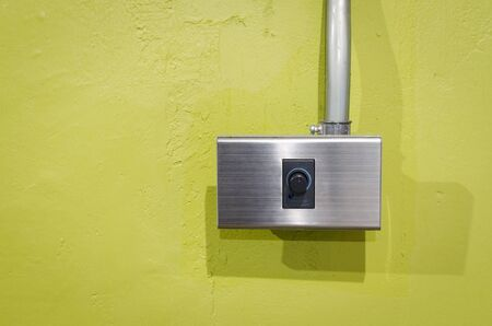 dimmer: Electrical Dimmer Switch on green wall Stock Photo