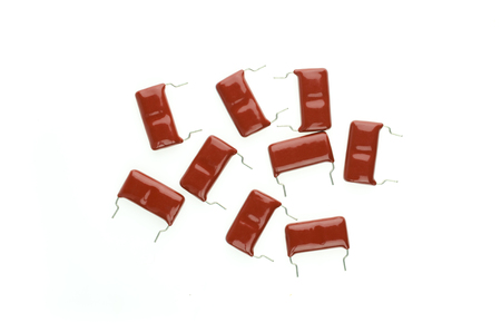 capacitor: Electronic Parts,Red mylar Capacitor batch isolate on white background