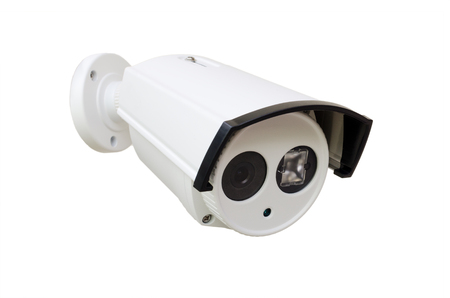 distrustful: white CCTV security camera on white background