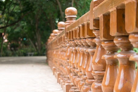 Row wood balustrade in garden photo