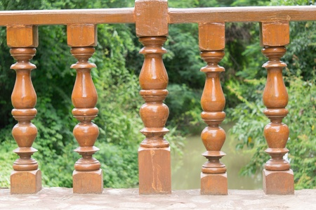 Wood balustrade on bridge in forest photo