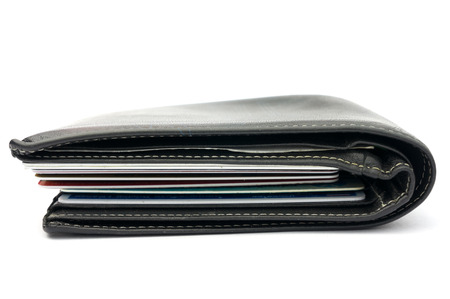 Card in black wallet on white  photo