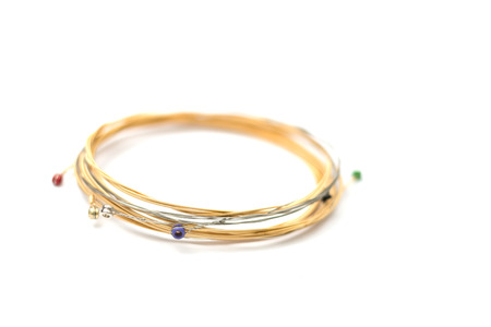 un used: New set of guitar string on white background