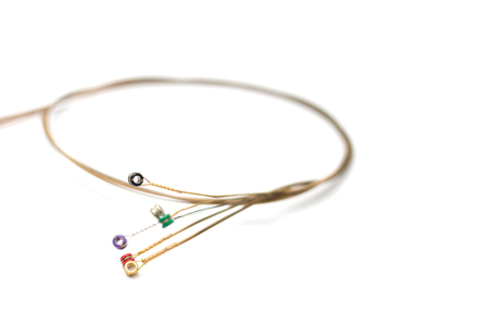 un used: Used set of guitar string on white background