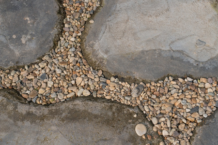 floor from pebble and stone in garden photo