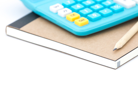 Blue calculator notebook and pencil on whitebackground