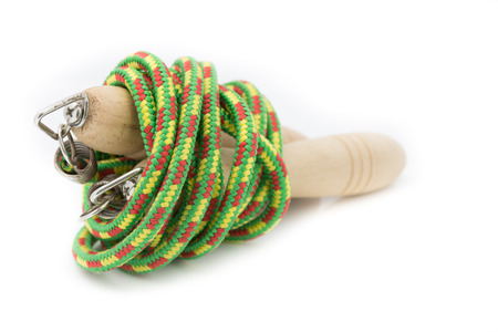 Wood green jump rope on white background