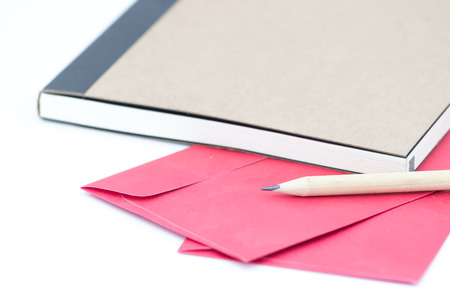 Note book file and pencil on whitebackground