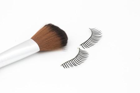 fake eyelashes: eyelashes and brush isolate on white background