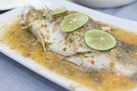 Steam fish in lemon sauce