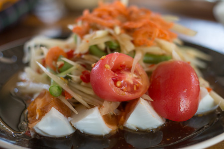 spicy thai papaya salad with tomato