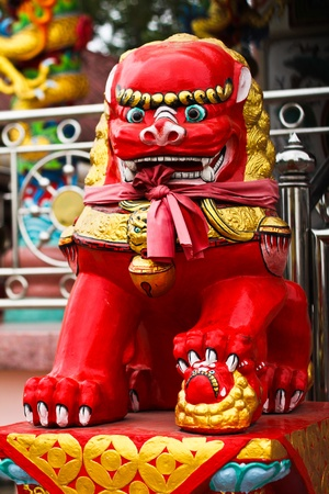 lion figurines: Red Lion in the shrine