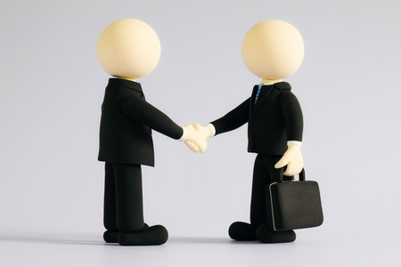 Two businessmen (doll) handshake4 photo