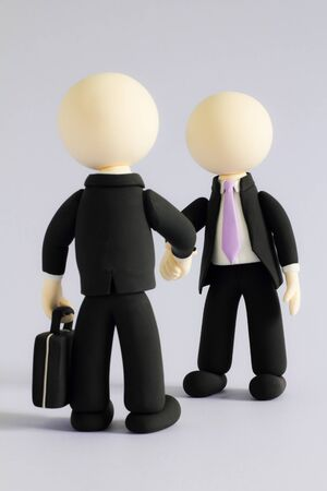 Two businessmen (doll) handshake2 photo