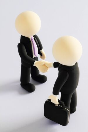 Two businessmen (doll) handshake (Side Shot) photo