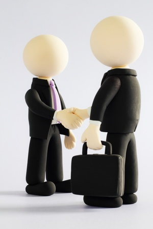 Two businessmen (doll) handshake1 photo