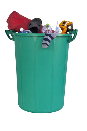 big bin: A big plastic green recycle bin filled with trash such as sock, toy, plastic drinking water bottle, shoe and bag isolated on white background.
