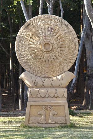 Sandstone Dharmachakra statue photo