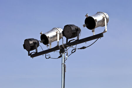outdoor lighting: Black and white spotlights on moblie stand for outdoor stage lighting