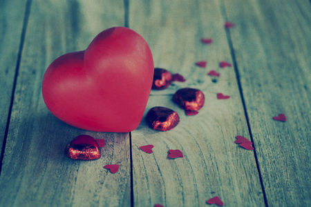 red heart on wooden floor for valentines day, vintage filtered photo
