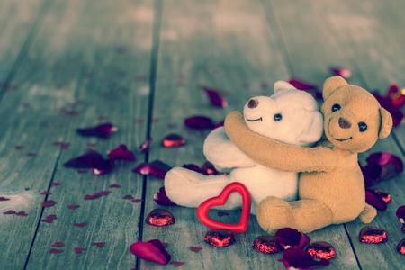 teddy: happy vintage bears on wood background, vintage filtered photo