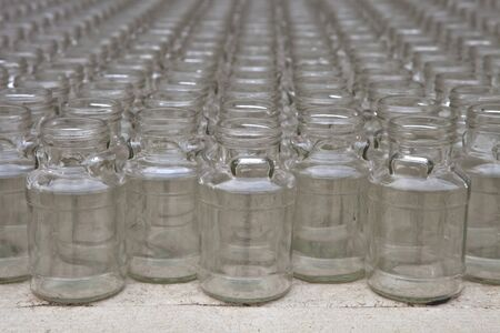 joining forces: empty clear glass bottles in rows