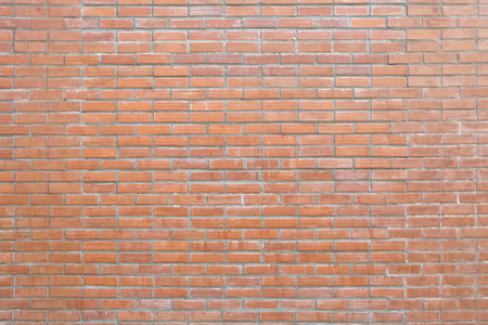 red brick wall background, the pattern of brick wall is double lines alternate single line Archivio Fotografico